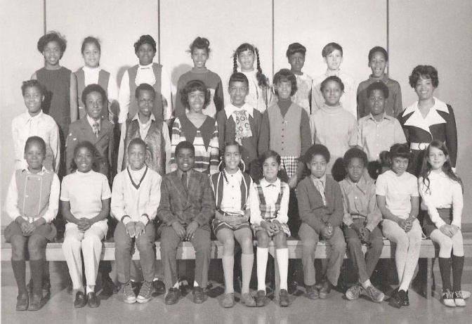 I sometimes write on race and occasionally people ask me where I get off writing about race. Well, this is my fifth-grade class picture. I'm at the far right in the first row. That's pretty much what all my classes looked like from the fourth grade through high school.